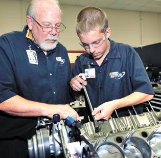Instructor Doug Wolfe assists student Aaron Anderson in the spec engine lab at the NASCAR Technical Institute in Mooresville.