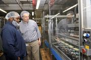 Operator Tavoris Cureton (left) chats with Jeremy Bowen, director of operations, in the packaging room at the Snyder's-Lance plant.