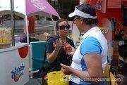 Vendors hand out freebies at Food Lion SpeedStreet.