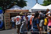 Festival-goers line up for free samples of North Carolina-made ice cream.