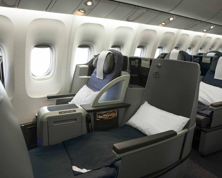 The new United interior offers 28 flat-bed cabin seats, replacing the 12 angled lie-flat and 26 reclining seats in the premium cabins on the traditional p.s. fleet.
