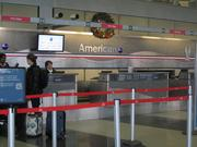 An unusually quiet moment at an American Air ticket counter at O'Hare.  Some of the customer service agent jobs at O'Hare were outsourced in the wake of the bankruptcy.