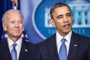 "U.S. President Barack Obama, right, speaks as U.S. Vice President Joseph ""Joe"" Biden looks on in the Brady Press Briefing Room at the White House in Washington, D.C., U.S., on Tuesday, Jan. 1, 2013."