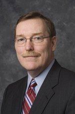 Navistar names Clarke CEO, narrows loss