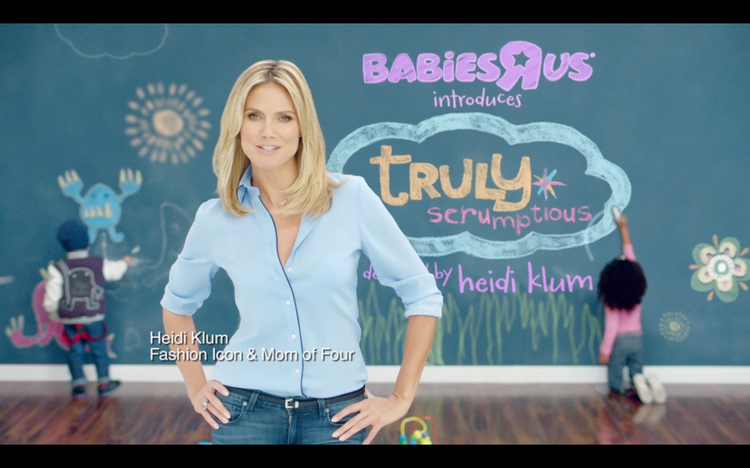 Heidi Klum has introduced a new kids line Truly Scrumptious at Babies 'R' Us, and the model stars in a new TV commercial touting the line.
