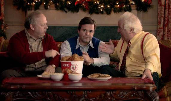 KFC is putting out new holiday videos that suggest feeding dysfunctional relatives the chicken chain's food may help bring peace and calm.