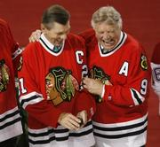 Hockey Hall of Famers and former Blackhawks players Stan Mikita and Bobby Hall will be seen in Comcast SportsNet's first rerun of classic Blackhawks games.