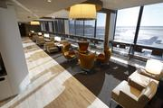 The remodeled United Club features updated furnishings and light fixtures and an airy look.