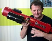 """""""Wassup!"""" creator Vinny Warren and his trusty potato launcher. Warren says it works well with tennis balls too."""