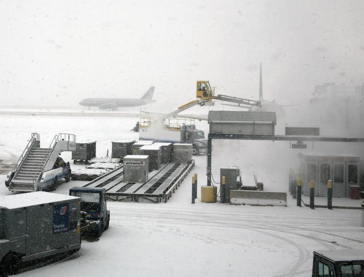In this file photo, snow blankets O'Hare International. As much as 10 inches of snow could accumulate in parts of Chicago today.
