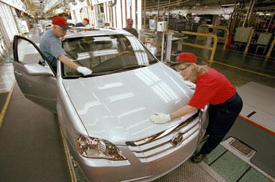 Workers inspect a vehicle at Toyota's Georgetown plant.