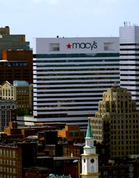 Macy's has given in and will be open beginning Thanksgiving night for the holiday season.