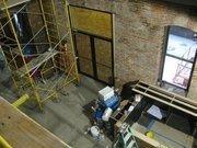 First-floor side door will open to patio in the adjacent alley.