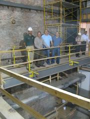 (From left to right) Jason McCoy, field manager for Core Resources, Paul Kitzmiller, Core Resources' CEO, and Ben Klopp and Bob Deck, principals of Four Entertainment Group, overlooking construction on 4EG's new bar on Sixth Street.