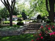 The grounds at 8680 Shawnee Run Road includes a private secret garden.