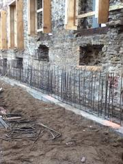 An earlier image from construction shows how the building's original stone facade was preserved during the renovation.