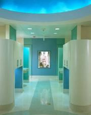 """With two large family-friendly restrooms on the ground floor, the Field Museum in Chicago features sufficient stalls and sinks, as well as eco-friendly hand-dryers. The women's restroom has a special nursing room with a shut door, sink, and small sofa for new mothers. The women's restroom also has a large """"Tot Area"""" with smaller toilets for its littlest guests.  Located in Chicago."""