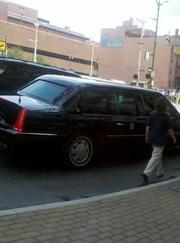 The presidential motorcade parked on Seventh Street just outside the Skyline Chili parlor.