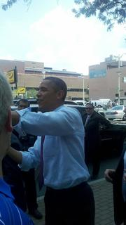 President Obama shakes hands with the crowd gathered on Seventh Street.