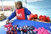 A Procter & Gamble volunteer fills up bags with essentials for victims of the storm.