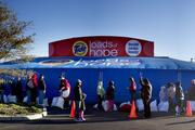 """A line of people waiting to do laundry at P&G's """"Loads of Hope"""" truck. More than 1,700 loads of laundry were completed through mid-day Friday."""