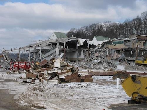 The grandstand is halfway demolished at River Downs in Anderson Township. Work began last month on tearing down the 9,000-seat structure.