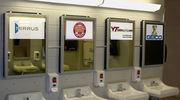 Digital mirrors at the Lane Stadium/Worsham Field at Virginia Tech display advertising and school messages when a visitor approaches the sink.