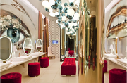 The $1.2 million Vanity bathroom has flat screen TVs over the urinals and faux reptile walls.