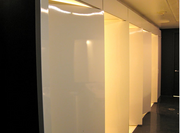 In the restrooms at the Walker Art Center in Minneapolis, the stall doors are glossy white art forms that contrast against black walls.