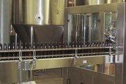 A bottle filler at the new Moerlein brewery.