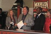 Greg Hardman speaks at a news conference Wednesday morning announcing the plant's opening with Mayor Mark Mallory, Vice Mayor Roxanne Qualls, and Councilwoman Laure Quinlivan on the left.