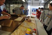 Students get ready at their stations. More than 1,000 meals are expected to be distributed.