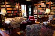 River High's library has original walnut built-in bookshelves on all four walls. The book collection is curated by Russell Speidel of Duttenhofer's Books. It also has a wood-burning fireplace, one of five in the home.