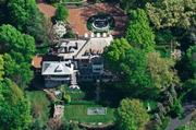 An aerial view of River High, the home sits on a 1.25-acre lot in Hyde Park.