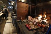 The restaurant has a woodfired stove.