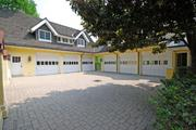 The property has an attached three-car garage and a detached three-car garage.