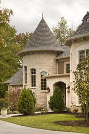 The turret at the front of the home is a true one, with a spiral staircase leading to the second floor and lower level.