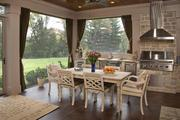 The enclosed patio also has dining and living room space.