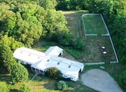 The 21-stall barn offers plenty of space for an owner interested in horses.