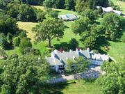 The home sits on 23 acres, offering a private setting.