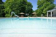 The 60,000-gallon pool is the home's original concrete pool.