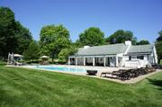 The pool house also includes two fireplaces.