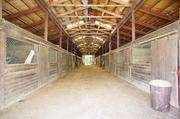 The inside of the 21-stall barn.