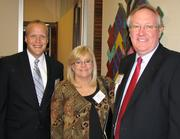 Trey Devey, president of the Cincinnati Symphony Orchestra, with Terri Hemmer, sales director for Blue Door Networks and Steve Hater, membership director for the Goering Center for Family & Private Business.