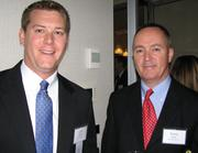 J.P. Miller of Humana and Terry Kelly, investment adviser for Bartlett & Co.