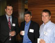 Pete Ventura, CEO of Integrity Express Logistics LLC, with Bryan Holland, partner at Holland Advertising, Interactive, and Matt Owens of IEL