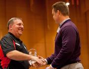 Trent Lucas, (right) partner with Legacy Financial Advisors, accepts the award for past winner 10 to 29 employees.