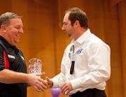 James Steeger, (right) president at Integrity Express Logistics, accepts the award for first-time participant 30 to 79 employees.