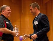Alex Allison, (right) director of marketing at DotLoop Co., accepts the award for veteran participant 30 to 79 employees.
