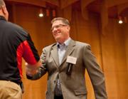 Craig Rhodes, (right) senior vice president/global head of human resources, accepts the award for first-time participant 80 to 299 employees.